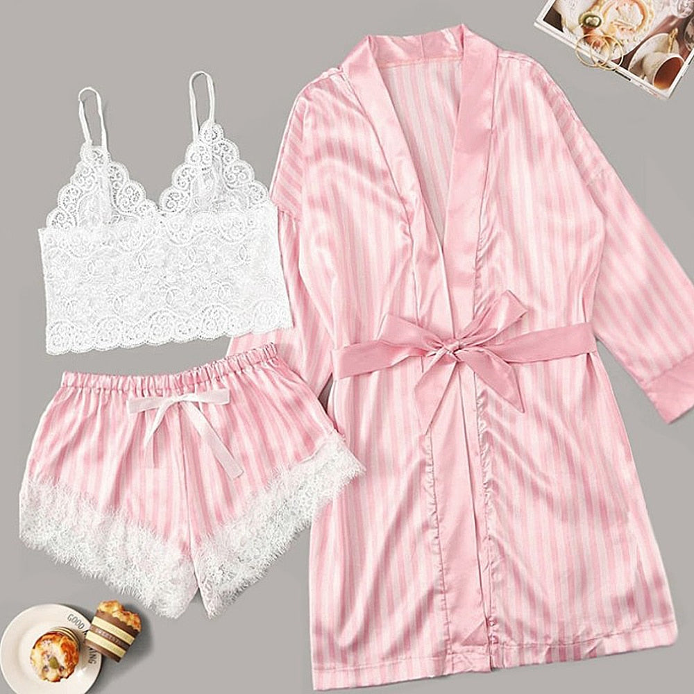Slip into this cute striped 3 Piece Pajama set and call it a night. The short top features lace, a V-neck and spaghetti straps, the bottoms have an elastic waist with a bow, lace and are short and the robe has three-quarter sleeves and a front tie. Color pink. Delivery 4-13 days. From our unique boutique.