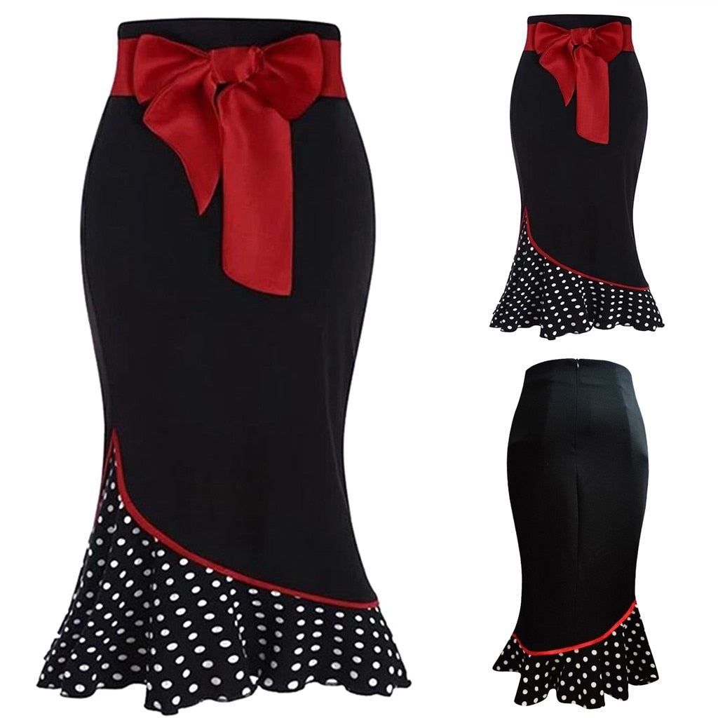 This elegant Fishtail Skirt will instantly become a seasonal favorite. This stylish skirt has a back zipper closure, ruffle polka dotted bottom, a large red bow, pattern stitching, empire waistline and falls mid-calf in length. Color black. Delivery 4-15 days. From our Utterly Unique Boutique. Description: Closure: Back Zipper, Fashion Element: Ruffles, Polka Dots, Pattern Stitching, Bow, Length: Mid-Calf, Material: Polyester, Waistline: Empire.