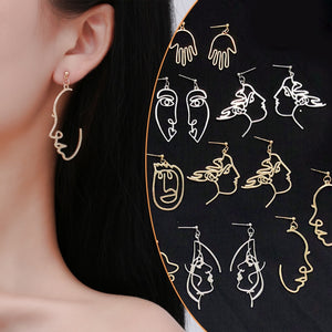 "Put on a happy face with these cute Dangling Face Earrings. Featuring drop earrings with a metal hollow out face and a push back closure. Your choice of 6 different faces or a pair of hands. Delivery 4-13 days. From our be unique boutique. Description: Metal: Alloy, Material: Metal, Design: Face, Hands, Size: 2.7"" Long, Closure: Push Back."