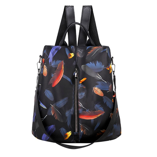 "This fun Feather Backpack features adjustable, removable straps, a soft handle, colorful feather pattern, waterproof, zipper closure, exterior zipper and interior zipper pocket. Color black. Delivery 4-13 days. From our Utterly Unique Boutique. Description: Material: Nylon, Closure: Zipper, Interior: Zipper Pocket, Exterior: Zipper Waterproof: Yes, Pattern: Colorful Feathers, Handle: Soft, Strap: Adjustable, Removable, Size: 12.2"" High x 6.3"" Wide x 12.2"" Long."