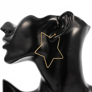 "These super cute trendy Hollow Out Star Earrings are a sure way to bring in the season. They're a drop earring and feature a hollow out star and a push backing. Choose from gold plated or silver. Delivery 4-10 days. From our Utterly Unique Boutique. Description: Backing: Push, Metal: Alloy, Material: Metal, Pattern: Star, Size: 2.2"" long, Type: Drop."