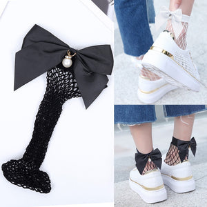 Stylish and unique these Super cute Fishnet Pearl Bow Socks can be dressed up or down. Featuring a bow with a simulated pearl, rhinestones and is short in length. Choose from black or white. Delivery 4-13 days. From our Utterly Unique Boutique. Description: Material: Nylon, Spandex, Fashion Element: Bow, Simulated Pearl, Rhinestones, Length: Short, One Size: Fits Most.