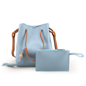This trendy 2 Piece Blue Shoulder Bag includes a large and small bag. They feature a soft textured feel, single studded strap and wristlet for the smaller bag, zipper closure, interior slot pocket and cell phone pocket on the large bag with tassel fringe and a wooden bead, both have a solid pattern. Color pastel blue. Delivery 4-13 days. From our unique boutique.