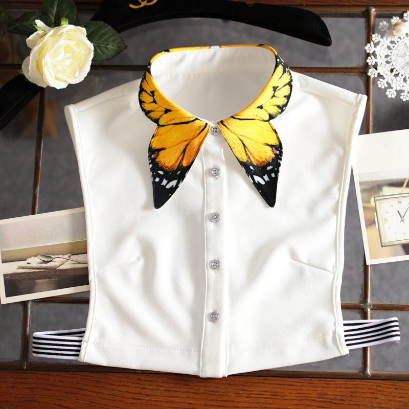 Butterfly Dickey - Utterly Unique Boutique - $12.99 - CUTE - FREE SHIP - Wear a dickey under a sweater or tee for a fresh, new look. This dickey is unique and features an elastic band, buttons and a pretty butterfly collar. From our Utterly Unique Boutique. Description: Fashion Element: Butterfly Collar, Material: Polyester, Closure: Buttons, Elastic Band, Sleeve: Sleeveless, How To Wear: Under Any