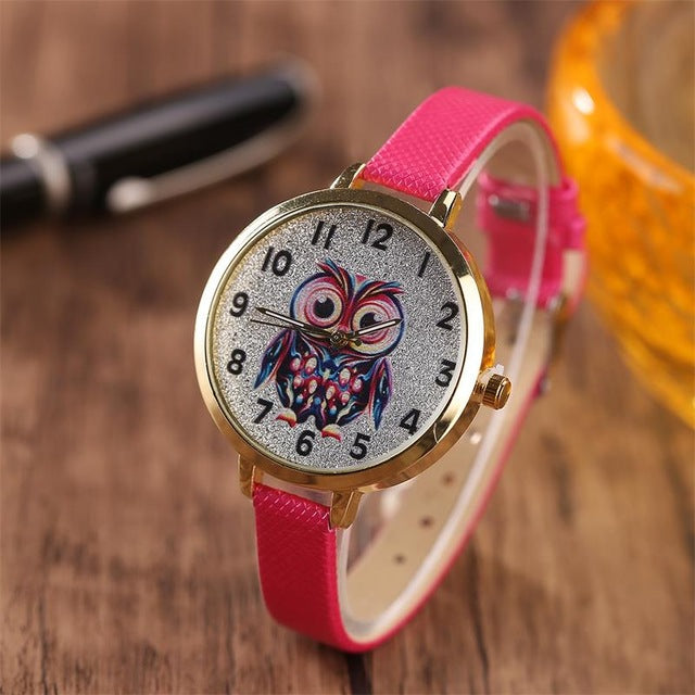"Owl Quartz Watch - Utterly Unique Boutique - $6.99 - Ships FREE - CUTE - Strap on this cute, Quartz owl watch which is sure to strike up a conversation. It features a leather/buckle band and a glass window with an owl surrounded by gemstones. Choose from 8 colors. From our Utterly Unique Boutique. Description: Movement: Quartz, Dial Diameter: 1.4"" (35 mm), Band Length: 8.7"" (22 cm), Band Width: 0.4"""