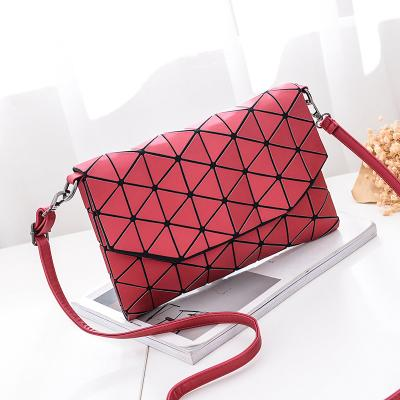 Small Geometric Crossbody Bag - Utterly Unique Boutique - FREE SHIP - From day to evening you'll be styling with this soft crossbody bag featuring a single strap, geometric design, magnetic snap closure and an interior compartment and slot pocket. Your choice of 6 colors. From our Utterly Unique Boutique. Description: Hardness: Soft, Strap: Single, Shape: Envelope, Pattern: Geometric, Interior: Compartment