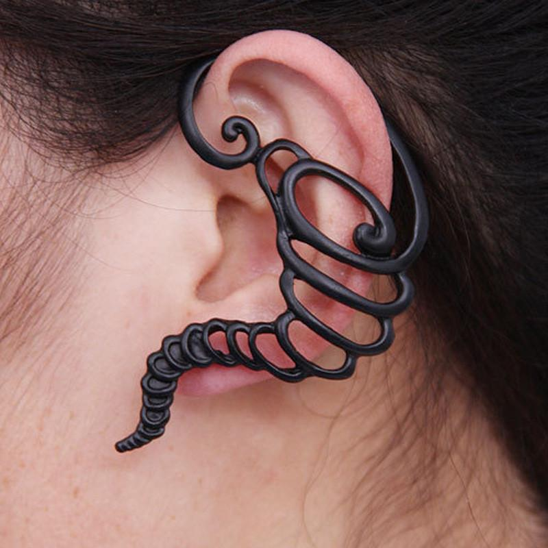 "Spiral Ear Cuff - Utterly Unique Boutique - $4.99 - Ships FREE - Unique - You'll be sure to want to wear your hair to the side with this cute spiral ear cuff made of alloy. Available in black. From our Utterly Unique Boutique. Description:Pattern: Solid, Fashion Element: Spiral, Material: Alloy, Size: 2.7"" x 1.9"" (6.8 cm x 4.7 cm)."