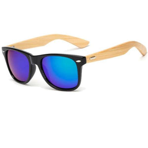 "Wooden Sunglasses - Utterly Unique Boutique - Bamboo - Unique Boutique - Grab some shade from our unique boutique with these wooden sunglasses made from bamboo. Your choice of 17 colors and 2 styles, gradient or mirror. Lense Optical Attribute: Anti-Reflective, Mirror, UV400, Gradient, Lense Material: Poly-Carbonate, Lens Height: 1.9"" (4.9 cm)Lens Width: 2.6"" (6.6 cm)Frame Material: Bamboo."