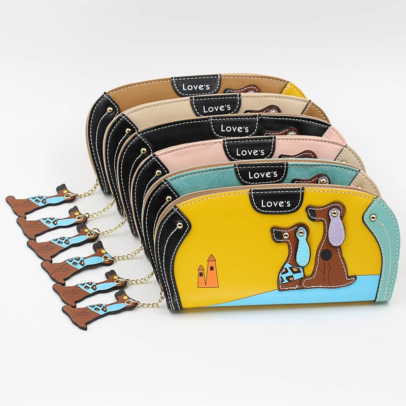 Long Dog Wallet - TRENDY - Unique Boutique - NEW - $14.99 - Holds Cell - This cute, long wallet is designed with 2 precious dogs and a castle on the front along with a zipper pull dog. It features an interior coin pocket, zipper pocket, slot pocket, note compartment, cell phone pocket, card holder and zipper closure. Choose from 6 colors. From our unique boutique. Description: Material: PU
