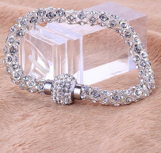"Dazzling Crystal Bracelet - Utterly Unique Boutique - 7.99 - Ships FREE - Dazzle them with this stylish crystal bracelet, sure to be an eye pleaser. This bracelet features a magnetic clasp and all around shining crystals. Your choice of silver or red. From our Utterly Unique Boutique. Description: Material: Crystal, Clasp: Magnetic, Shape: Round, Length: 8.2"" (21 cm)."