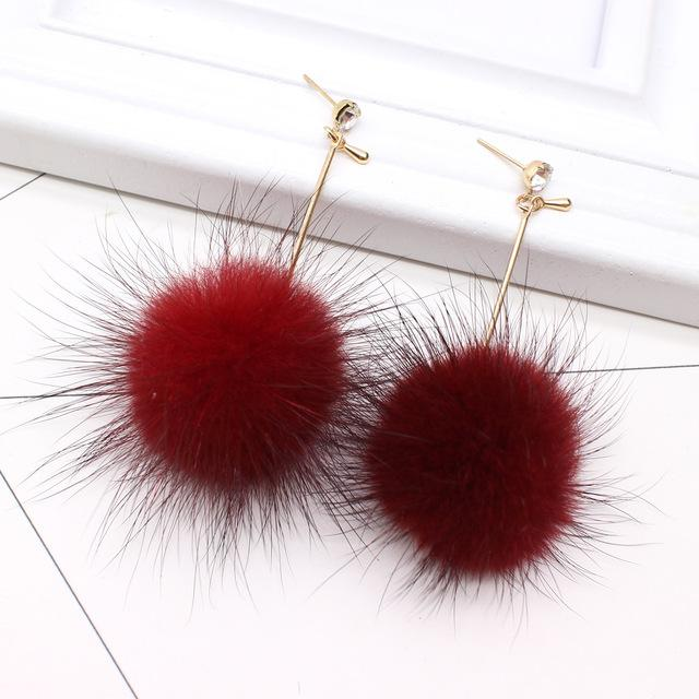 Pom Pom Long Drop Earrings - Utterly Unique Boutique - $5.99 - FREE Ship - These fluffy, snowball, drop earrings are cute and will make anyone want to touch them, they're soft and made of crystal with a post backing. Your choice of 8 colors. From our unique boutique. Description:Material: Crystal, Shape: Round, Metals: Zinc Alloy, Hardness: Soft, Backing: Post.
