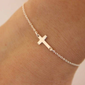 Side Cross Bracelet - Utterly Unique Boutique - $3.99 - FREE Shipping - This elegant and beautiful side cross bracelet is versatile enough to go with anything in your wardrobe. Featuring a metal cross, tension mount and link chain. Choose from gold plated or silver. Buy one for yourself or give as a gift. From our Utterly Unique Boutique. Description: Shape: Side Cross, Setting: Tension Mount