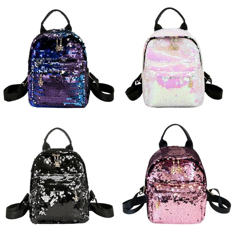Sequin Backpack - Be Unique Boutique - NEW $18.99 - FREE SHIPPING - Carry around this trendy backpack featuring a zipper closure, charms, adorned in sequins, solid pattern, an interior slot pocket, exterior zipper pocket, adjustable straps and a soft handle. Choose from 4 colors. From our be unique boutique. Description: Lining Material: Polyester, Pattern: Solid Closure: Zipper, Material: