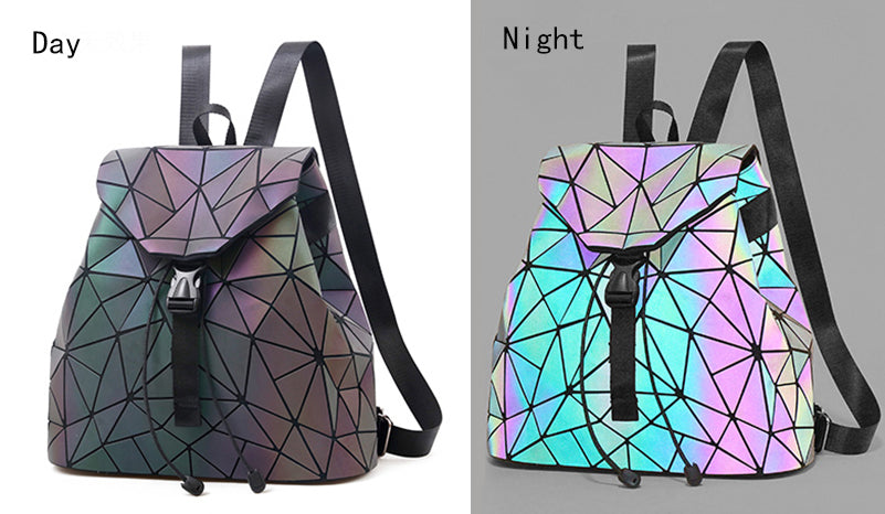 Light Up Backpack - Utterly Unique Boutique - $29.99 - Cool - FREE SHIPPING - This unusual backpack will be a perfect conversation piece for the up coming season with its unique light up design. It features a soft adjustable strap, handle, lights up in the dark, futuristic pattern, large capacity, clasp/drawstring closure, an interior compartment, zipper pocket, slot pocket and cell phone pocket. Your choice of 2 styles. From our Utterly Unique Boutique.