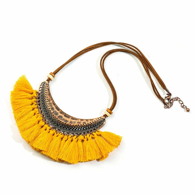 "Tassel Necklace - Utterly Unique Boutique - $6.99 - Ships FREE - FUN - Wear this fun Bohemian necklace or give as a gift. Featuring a cowhide rope chain, lobster clasp and a row of beautiful tassels. Choose from 9 colors. From our Utterly Unique Boutique. Description: Style: Bohemian, Metal: Zinc Alloy, Size: 6"" x 2"" (14 cm x 5.5 cm), Material: Metal, Tassels, Chain: Rope, Cowhide, Closure: Lobster Clasp."