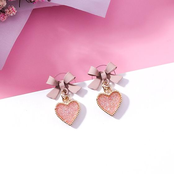 "Bow Heart Earrings - Utterly Unique Boutique - $4.99 - SHIPS FREE - These popular bow heart earrings are super cute! They feature a detailed bow and a heart with a push backing. Available color pink. From our Utterly Unique Boutique. Description: Metal: Zinc Alloy, Shape: Heart, Bow, Material: Metal, Size: 1"" long (2.5 cm long), Backing: Push Back."