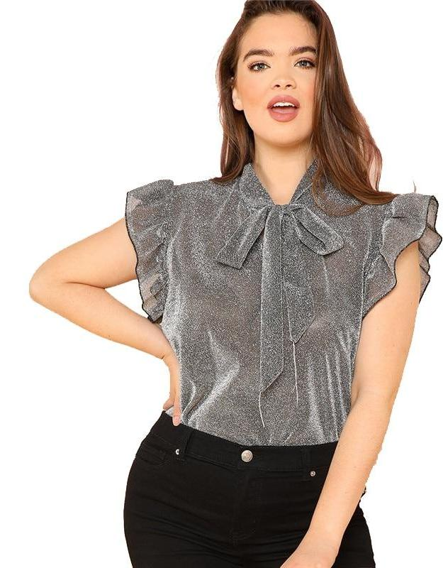 Shiny Bow Top - Utterly Unique Boutique - $13.99 - 0X-3X - SHIPS FREE -  Go from office to evening in this beautiful, shiny bow top which will soon become your favorite. The top has some stretch and features a short butterfly sleeve, ruffles, a solid pattern, a tie and a stand collar. Size 0X-3X. Available color gray. From our Utterly Unique Boutique. Description: Material: Polyester, Sleeve