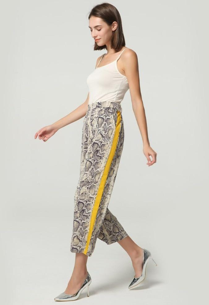 Side Stripe Snake Pants - Unique Boutique - $15.99 - SHIPS FREE - CUTE - Slither into these comfortable, trendy snake print pants featuring pockets, elastic waist, cropped length and a side stripe. From our unique boutique. Description: Length: Cropped, Closure: Elastic Waist, Waist: Mid, Pant Style: Straight, Fashion Element: Side Stripe, Pockets, Material: Polyester, Spandex, Pattern: Snake Print.
