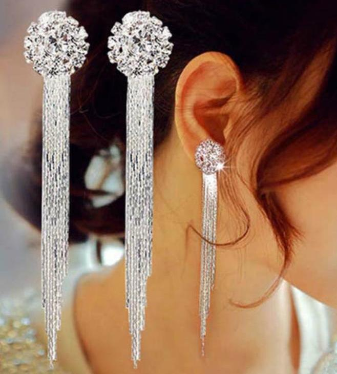 Long Tassel Earrings - Unique Boutique - SHIPS FREE - GLAM - $4.99 - These shiny, glamorous, long tassel earrings are sure to be a hit. The drop earrings feature a post backing and are very comfortable and light. Available color silver. From our unique boutique. Description: Material: Crystal, Metal, Metal: Alloy, Earring Type: Drop Backing: Post, Weight: Very Light.