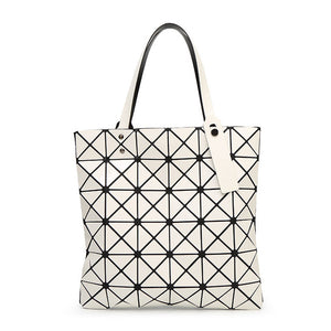 Geometric Handbag - Utterly Unique Boutique - TRENDY - FREE Shipping - You're sure to stand out when you carry this popular geometric handbag that features a zipper closure, double straps, satin lining, interior zipper pocket/cell phone pocket and a geometric pattern. Choose from 13 colors. From our Utterly Unique Boutique. Description: Lining Material: Satin, Number Of Straps: Two, Hardness: Soft, Closure: Zipper