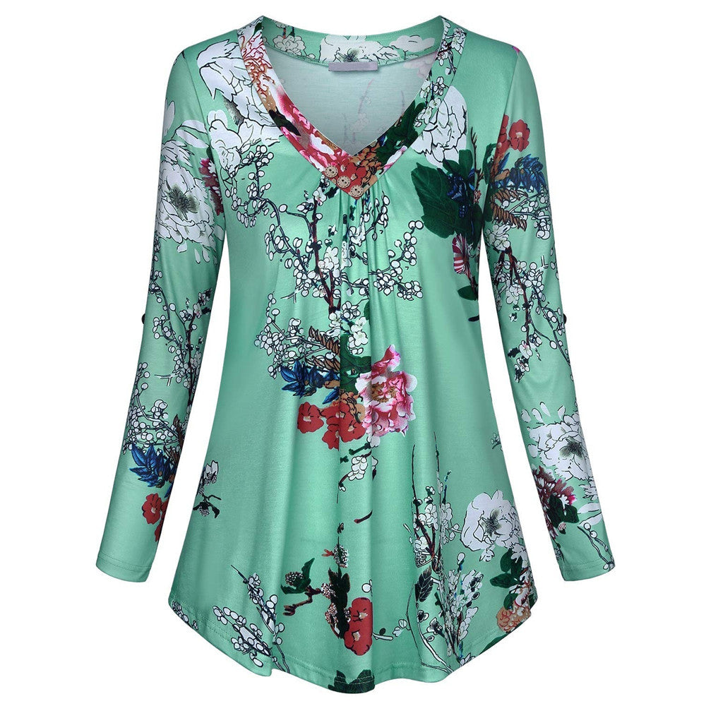 Long Sleeve Tunic - Utterly Unique Boutique - CURVY SIZES TOO - NEW - This beautiful tunic top features a floral print with a flattering v-neck, 3 buttons and roll tab sleeves. Pair it with pants or jeans for a cute look. Your choice of 5 colors. Delivery time 4-7 days within the U.S. From our Utterly Unique Boutique. Description: Material: Polyester, Sleeve Length: Full, Fashion Element: Buttons