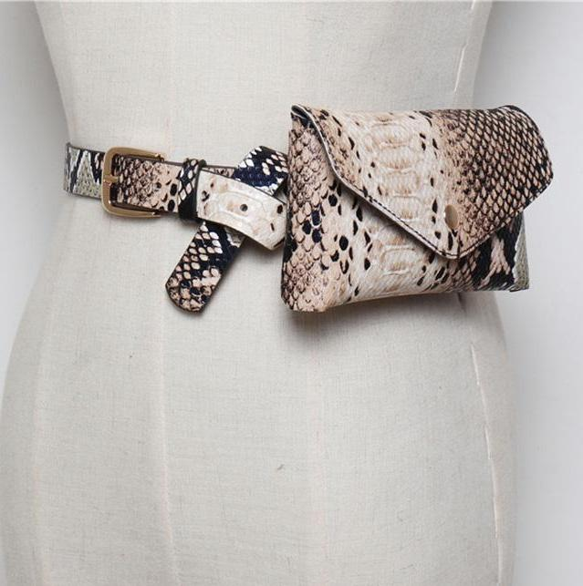 "Snake Print Belt Bag - Unique Boutique - $13.99 - SHIPS FREE - TRENDY - Trendy and on point for the season, this awesome belt bag is hands free, has a snap closure and a printed snake pattern. Choose from 4 colors. From our unique boutique. Description: Type: Belt Bag, Material: PU, Pattern: Snake Closure: Snap Belt: 42"" long (106 cm long), Bag: 7"" long x 4"" high, (17 cm long x 9.5 cm high), Fits"