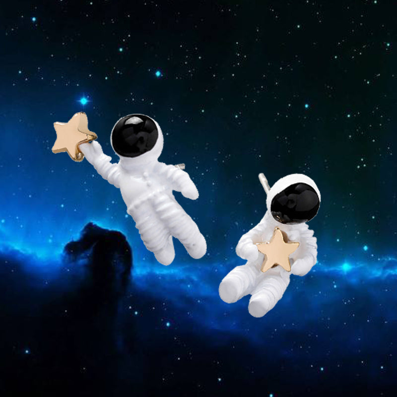 "Astronaut Earrings - Utterly Unique Boutique - $5.99 - FREE SHIPPING - These astronaut earrings will take you to the moon and back. They feature a post backing and are in the shape of an astronaut carrying a gold plated star. From our Utterly Unique Boutique. Description: Backing: Post, Metal: Zinc Alloy, Material: Metal, Shape: Astronaut, Size: 0.8"" wide & the second 0.4"" wide (2.1 cm wide"