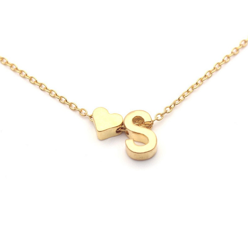"Tiny Initial Necklace - Utterly Unique Boutique - $4.99 - SHIPS FREE - Choose your letter and express yourself with this cute heart and letter necklace. Featuring a link chain, letter and heart. Choose from letters A-Z in gold tone or silver. From our Utterly Unique Boutique. Chain: Link, Metal: Zinc Alloy, Pattern: Heart, Letter, Pendant Size: 0.4"" (1 cm), Chain Length: 18"" (45 cm)."
