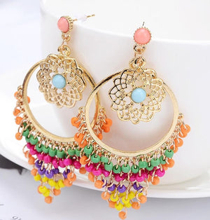 "You'll love putting on these Beaded Boho Earrings. They simply go with everything. They feature multiple tiered beads, are drop earrings, round shape with a post back. Color Multi-Colored. From our Utterly Unique Boutique. Description: Shape: Round, Backing: Post, Material: Beads, Type: Drop, Material: Alloy, Size: 3"" x 1.5""."