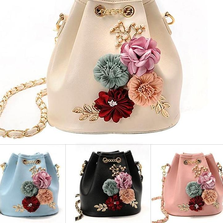 Floral Applique Bag - Utterly Unique Boutique - TRENDY - FREE SHIPPING - You'll stand out in the crowd while carrying this beautiful bag. It features applique flowers, simulated pearls, a chain strap, bucket shape, interior slot pocket and exterior slit pocket. Your choice of baby blue, pink, beige or black. From our Utterly Unique Boutique. Description: Lining Material: Polyester, Fashion