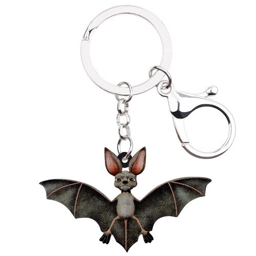 "Have some fun and hang this Bat Keychain from your keys, handbag, belt loop or anywhere you choose! This accessory is easy to clip. Give as a gift. Available color black. Delivery 4-10 days. From our Utterly Unique Boutique. Description:Item: Bat Keychain, Use: Clip On Your Keys, Handbag , Belt Loop Or Where Ever You Choose, Fashion Element: Two-Ring Design Allows You To Wear It, Material: Resin, Key Ring Diameter: 0.8"", Charm Size: 1.3"" Tall x 2.1"" Wide, Total Length: 6.1""."