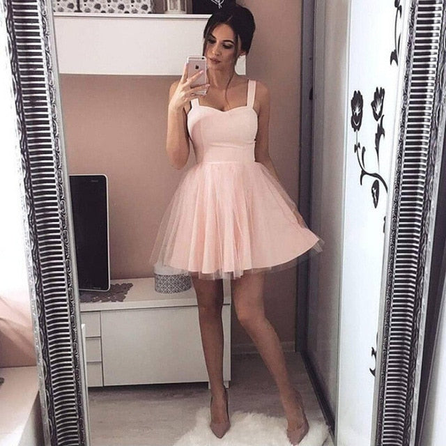 Adorable Tulle Dress - Utterly Unique Boutique - $14.99 - SHIPS FREE - This adorable tulle dress is absolutely perfect for that night out. It features a solid pattern, zipper closure, double tiers, mesh, is sleeveless, tank style, and falls above the knee. Choose from pink or black. From our Utterly Unique Boutique. Description: Material: Mesh, Cotton Blend, Pattern: Solid, Sleeve Length: Sleeveless, Fashion Element: