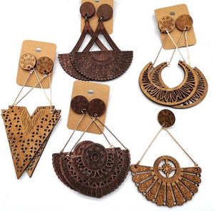 5 Pair Wooden Earrings - Utterly Unique Boutique - $9.99 - SHIPS FREE - No need to decide which pair to get because you get all 5 pairs! These drop earrings are made out of wood and feature a push-back closure. From our Utterly Unique Boutique. Description: Type: Drop, Material: Wood, Metal: Alloy, Includes: 5 Pairs, Closure: Push-Back.