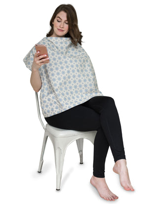 Woman wearing Aster Nursing Cover while on her cell phone