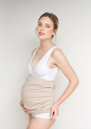 Pregnant woman in Belly Band Nude/Beige Protective Maternity Band