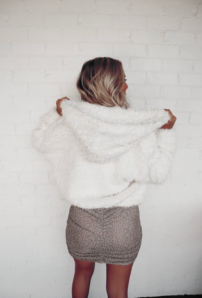 white fur zip up hoodie