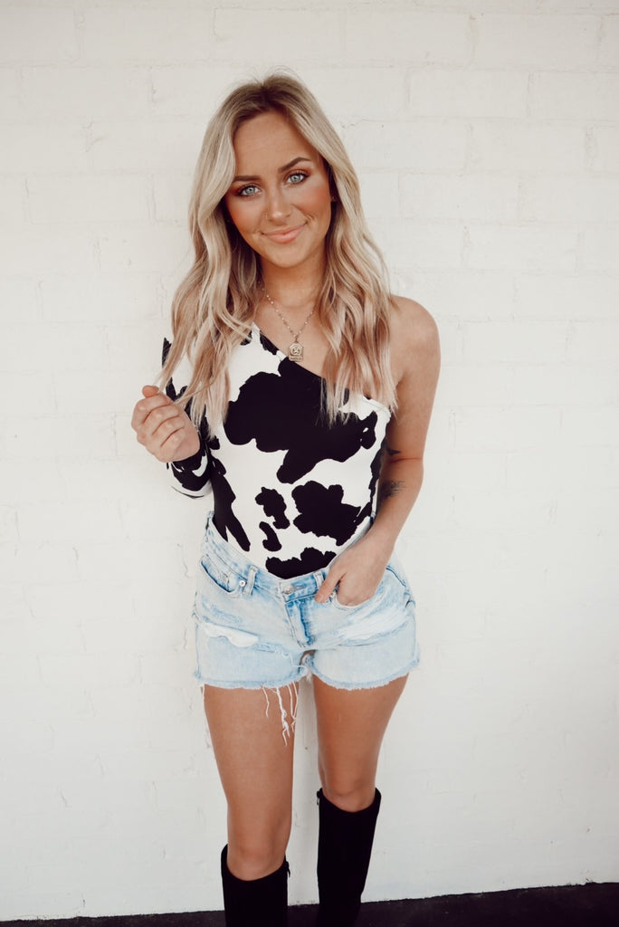 one shoulder cow print bodysuit