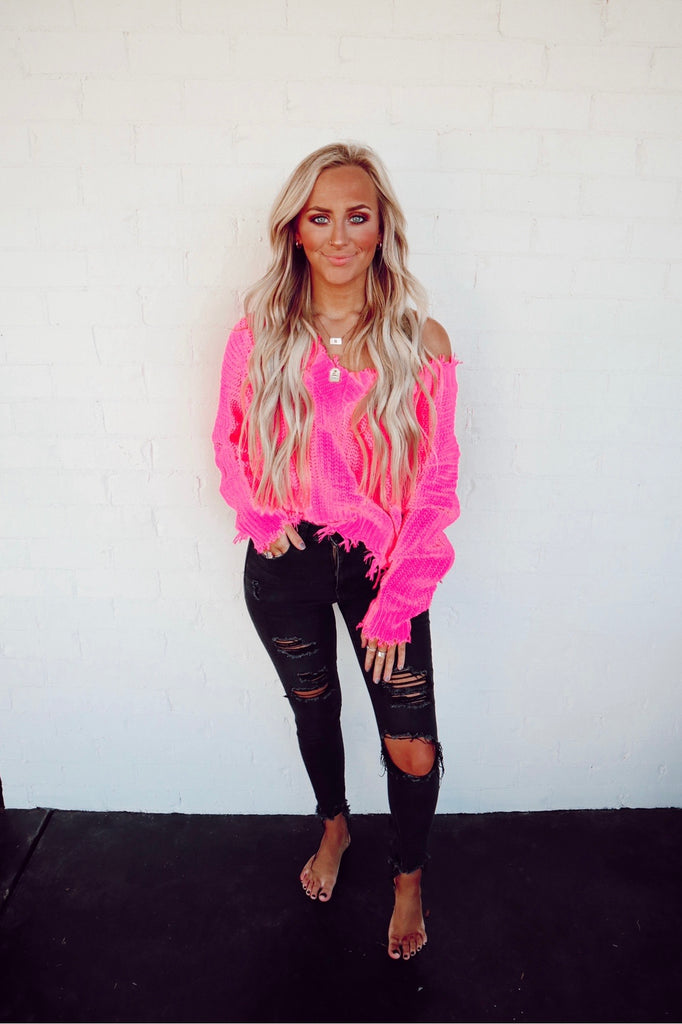 neon pink distressed sweater