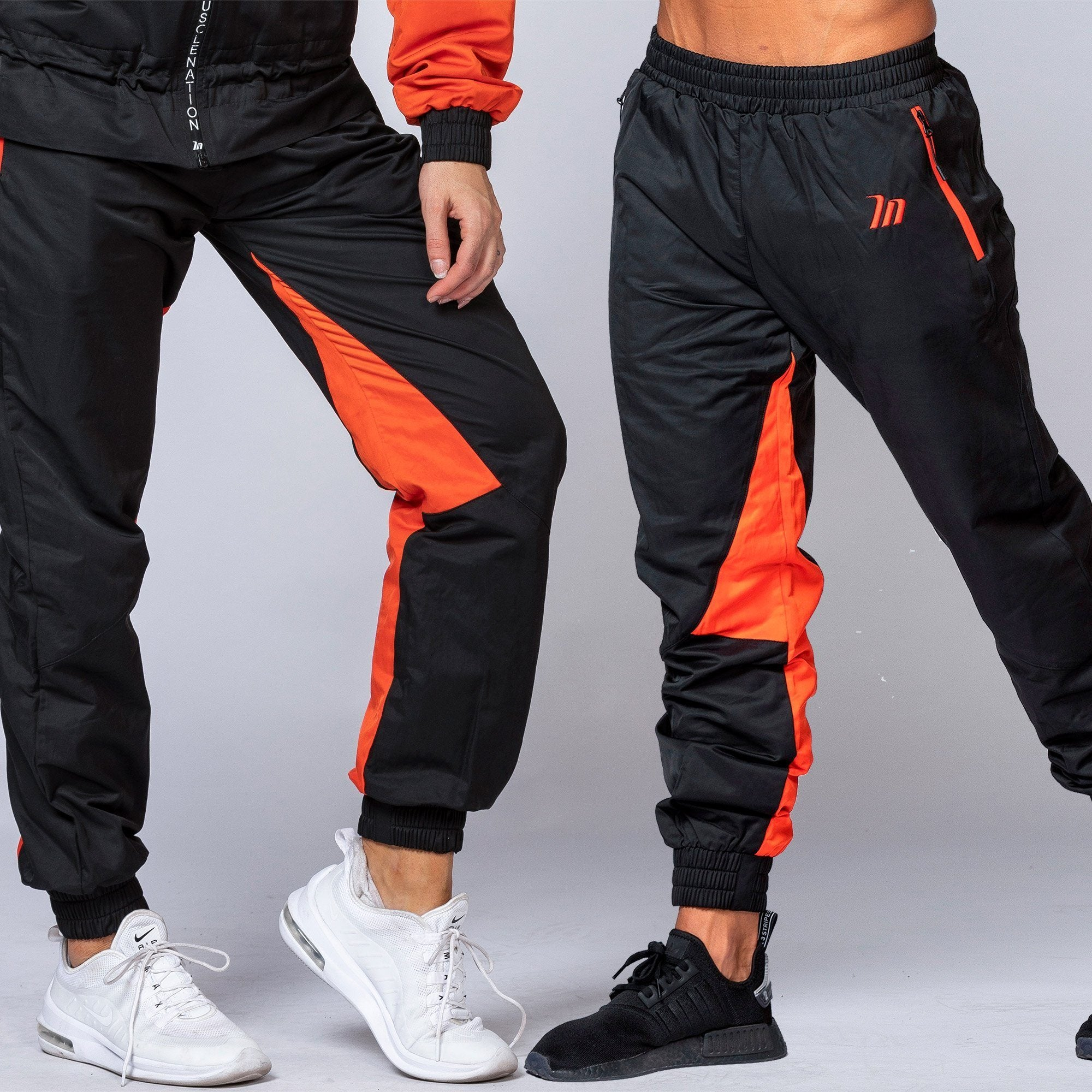 Muscle Nation Unisex Tracksuit Pants - Black/ Blood Orange