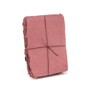 Pack of red shimmering handmade paper made with 100% cotton recycled from the apparel industry.