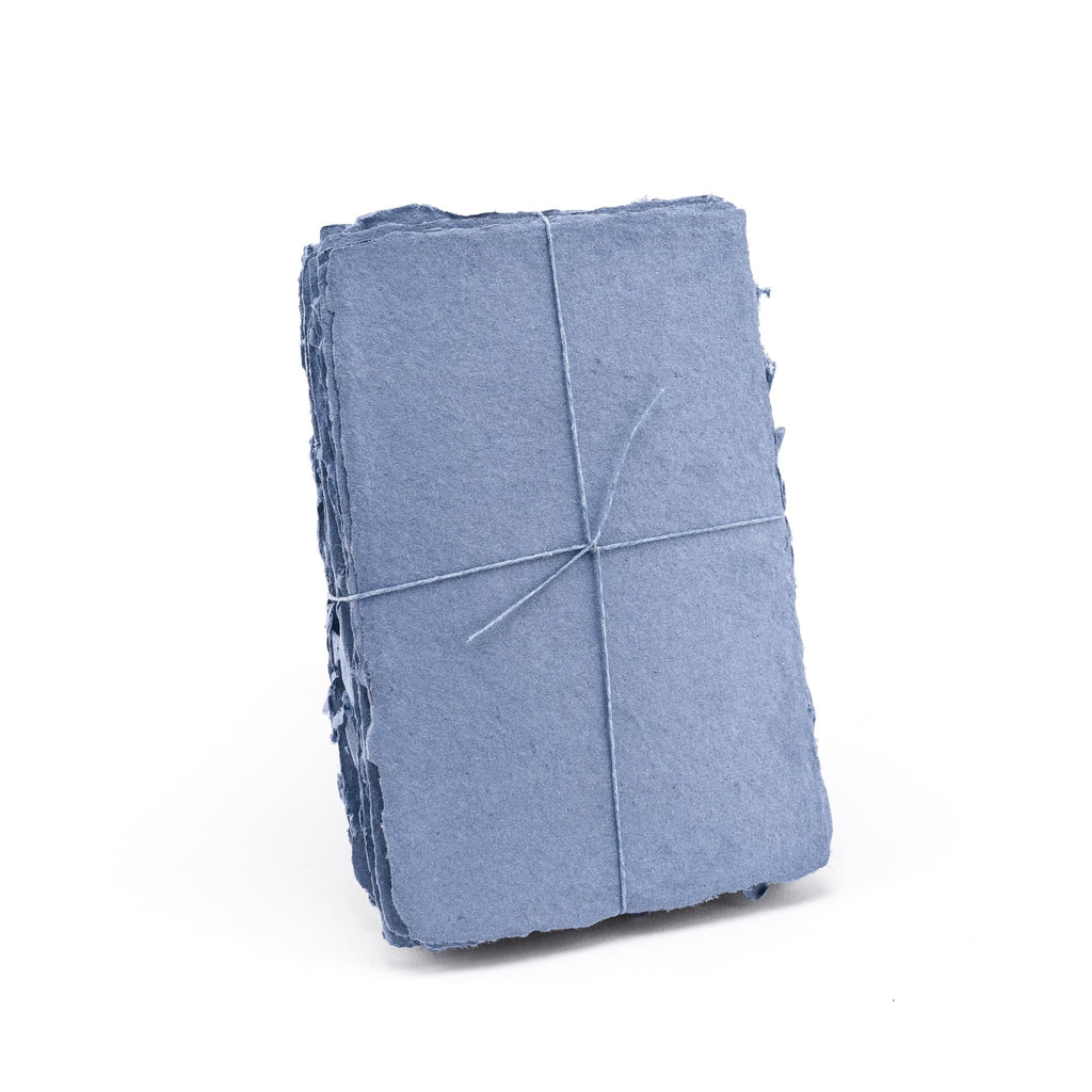 Pack of blue shimmering handmade paper made with 100% cotton recycled from the apparel industry.