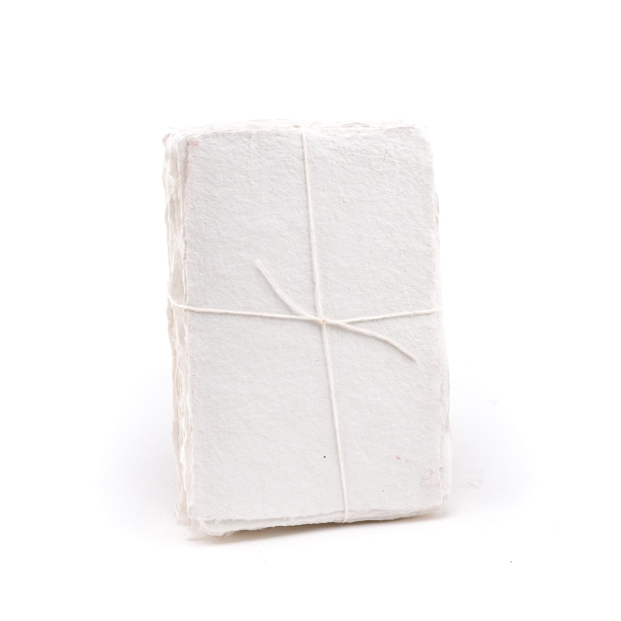 Pack of white shimmering handmade paper made with 100% cotton recycled from the apparel industry.