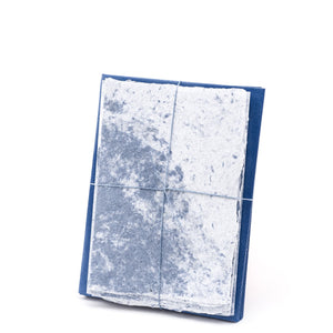 Speckled cotton handmade paper stationery set in swirled blue and white with matching envelopes.