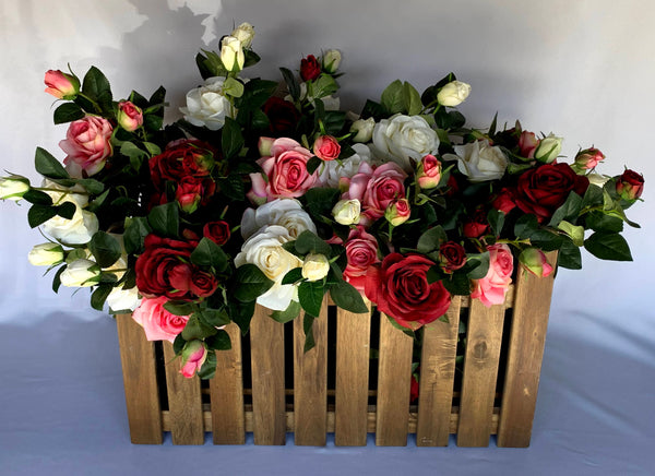Wooden crate filled with roses