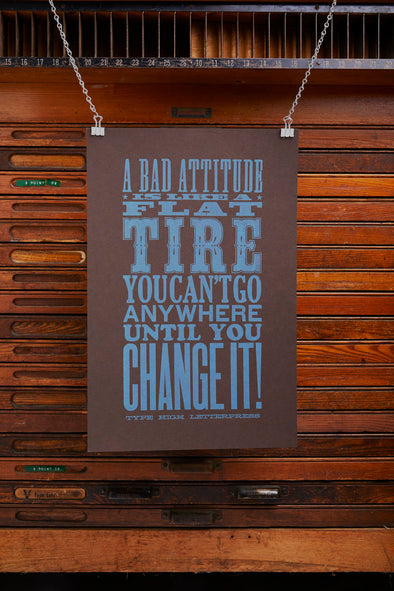 One color letterpress poster with the quote, A bad attitude is like a flat tire, you can't go any where until you change it.