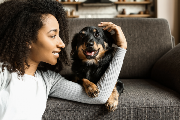 Smiling woman looking at her dog
