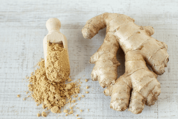 natural pain relief for dogs: grated and whole ginger side by side