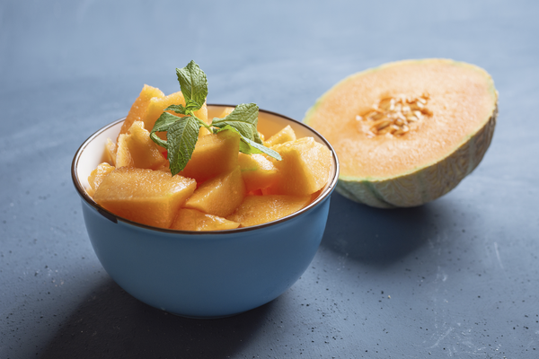 can dogs eat cantaloupe: diced cantaloupe in a bowl