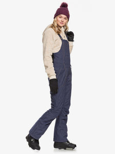 Roxy Women's Rideout Bib Snow Pant Mid Denim modeled side view