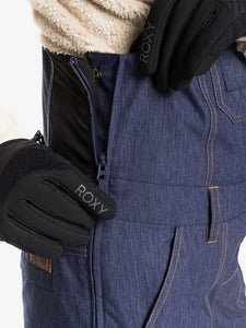 Roxy Women's Rideout Bib Snow Pant Mid Denim close-up view modeling front pocket